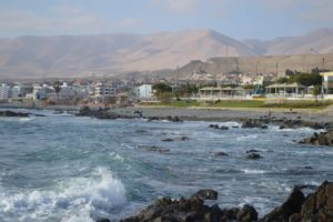 a photo of the coast of Ilo Peru showing the small city in the distance and part of the ocean front